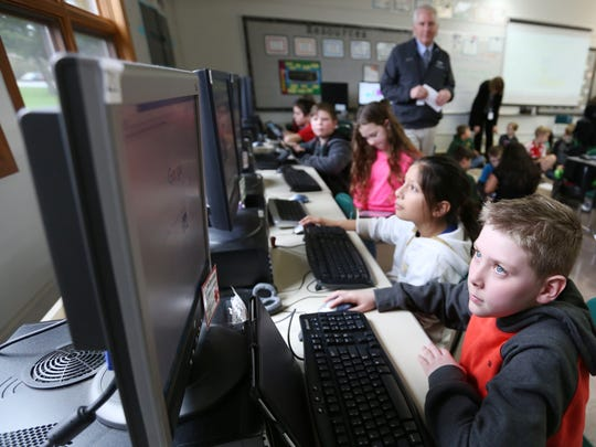 Noah Bourgeois, 9, learns about how to be safe on the internet during class Tuesday, March 1, 2016, at North Marion Intermediate School in Aurora, Ore.