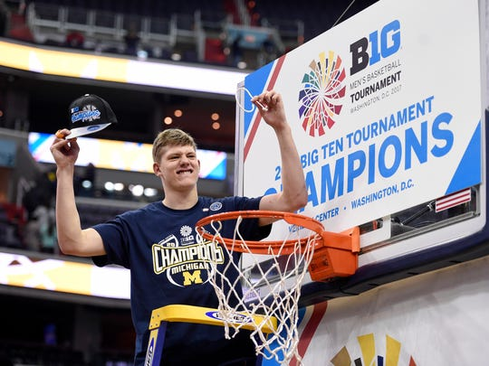 Michigan forward Moe Wagner celebrates while cutting