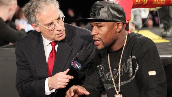 Floyd Mayweather talks to Showtime's Steve Farhood during a fight last year.