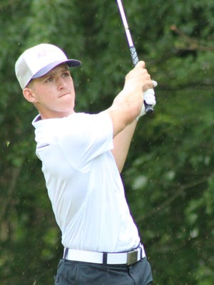 Darin Hudak watches his shot during the Windmill Classic Thursday at Windmill Lakes Golf Club in Ravenna. Hudak earned medalist honors as Tallmadge finished fifth out of 13 teams.