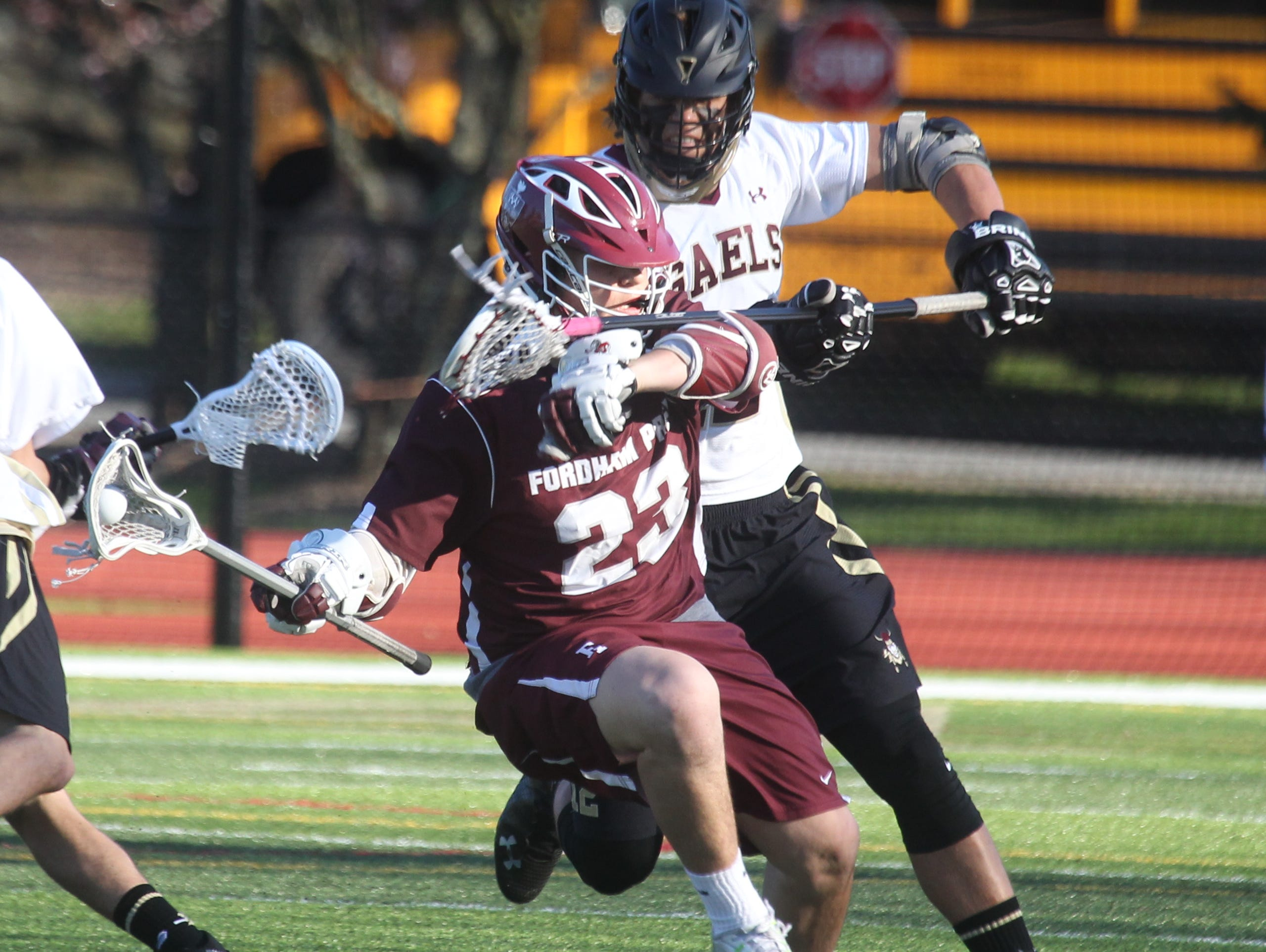 Fordham Prep's Edward Madden is pressured by Iona Prep's Zach Kryza during their game at Iona Prep April 15, 2016. Fordham Prep won 8-7.