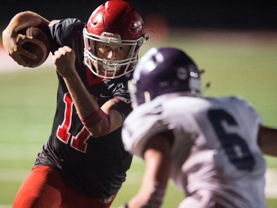 Halls' quarterback Caden Tollett rushes to the end