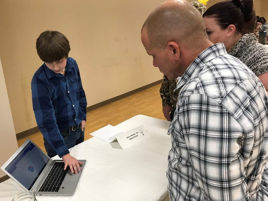 Tioga Junior High School seventh-grader Dillon Millard talks about why he chose to study the nation's opioid crisis for a school project, which culminated with a presentation Tuesday.