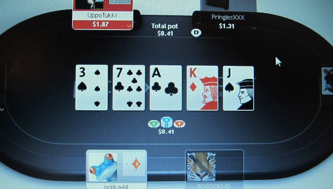 A computer screen in Atlantic City shows a game of online poker in progress.