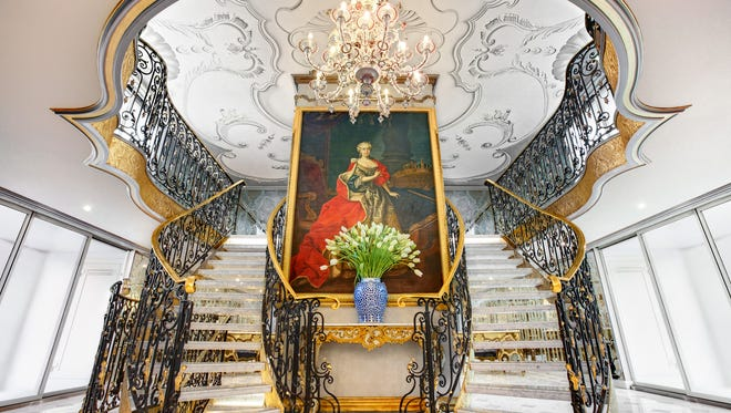 The design centerpiece of the ship is the three-tiered lobby. A sweeping marble staircase with a wrought-iron, hand-gilded balustrade, and royal crown detailing is dominated by an 10-foot high oil on canvas painting of Maria Theresa.