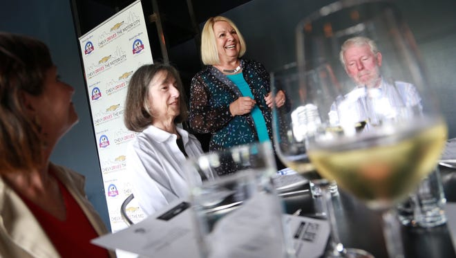 Detroit Free Press reporter Sylvia Rector talks with guests, left to right, Dr. Donna Brode, Nadia Bannon and Brian Bannon all of Windsor, during the Detroit Free Press Top 10 Takeover dinner series at the Selden Standard in Midtown Detroit on Tuesday June 30, 2015.