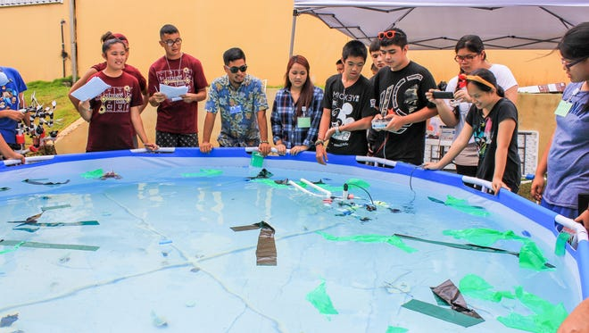 In this file photo, students from the Guam Community College's first Sustainable Technologies and Environmental Education Program compete to see which of four submarines they built perform the best.