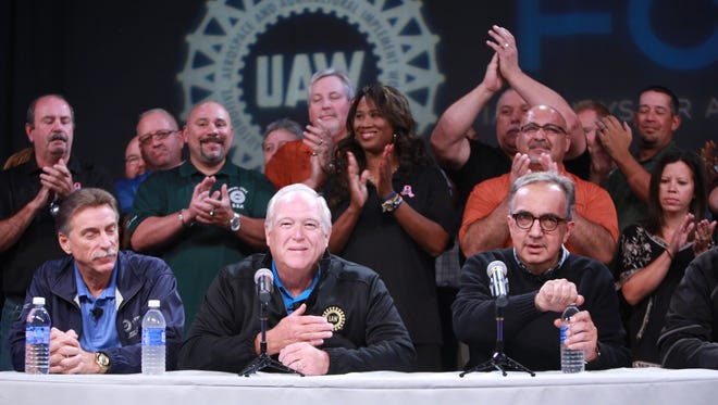 UAW President Dennis Williams and FCA CEO Sergio Marchionne speak during a press conference in the auditorium of the UAW-Chrysler NTC Building in Detroit after the UAW announced Tuesday that it has reached a tentative agreement with FCA US LLC.