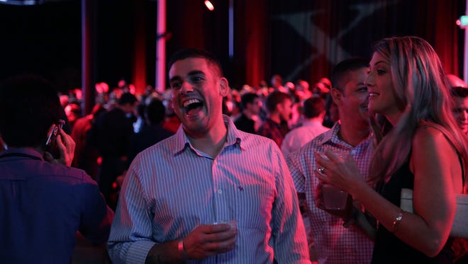 Attendees party during the Tesla Motors Model X launch event in Fremont, Calif., Sept. 29, 2015.