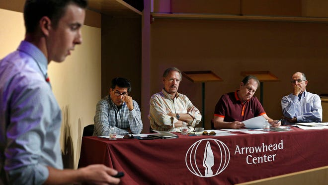 Judges, from left, Dino Cervantes of Cervantes Enterprises, real estate developer Mickey Clute, Royal Jones of Mesilla Valley Trucking and Lou Sisbarro of Sisbarro Dealerships, listen to entrepreneur Taylor Burgett, CEO of Byteware, during the Aggie Shark Tank event at Pete Domenici Hall on Wednesday, Aug. 12, 2015. (Photo by Andres Leighton) SEP15