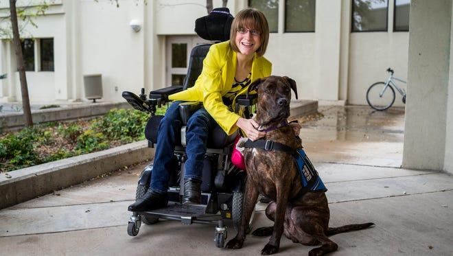 Kaity Ellis and Ranger, a multipurpose service dog and  Ellis' new lifelong partner.