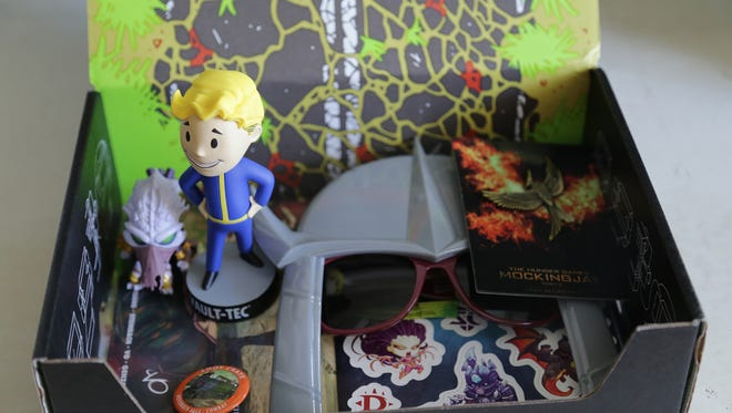 """Vault Boy, Shredder, Hunger Games and Blizzard get some love in Loot Crate's November 2015 """"Combat"""" box."""