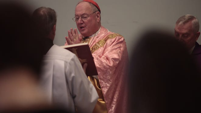 Close to 2,000 congregation members attend a Mass lead by Cardinal Dolan at  St. Ann's Catholic Church in Ossining on Sunday.  The congregation filled the church and the local school to hear the Mass.