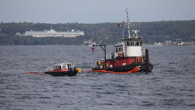The Rochelle Kaye tugboat assists in pulling a 50-70ft boom while demonstrating the techniques used to prevent oil spilled from moving on Lake Huron during the Enbridge emergency response exercise at the Straits of Mackinac on Thursday September 24, 2015.