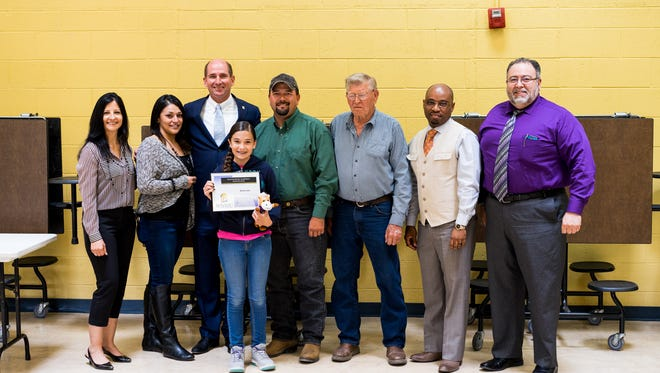 Hurley Elementary School student Winter Lewis, fourth from left, was awarded special scholarship to WNMU on Thursday. Attending the presentation were, from left, Margaret Kessler, Hurley Elementary Principal; Rebecca Barragan, Hurley Elementary sixth-grade teacher; Dr. Joseph Shepard, WNMU President; Roy Lewis, Roger Lewis, Isaac Brundage, WNMU Vice President of Student Affairs; and Matthew Lara, WNMU Director of Admissions.