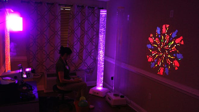 Michelle Meeker, Behavioral Health manager at Signature Healthcare, shows what the multi-sensory room can do.