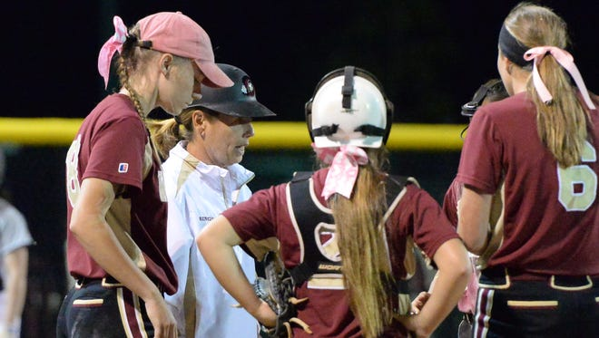 Riverdale coach Christi Bingham talks to players during a postseason game last year. The Lady Warriors will be hosting the Southern Warrior Classic softball tournament beginning Thursday as fields across the county.