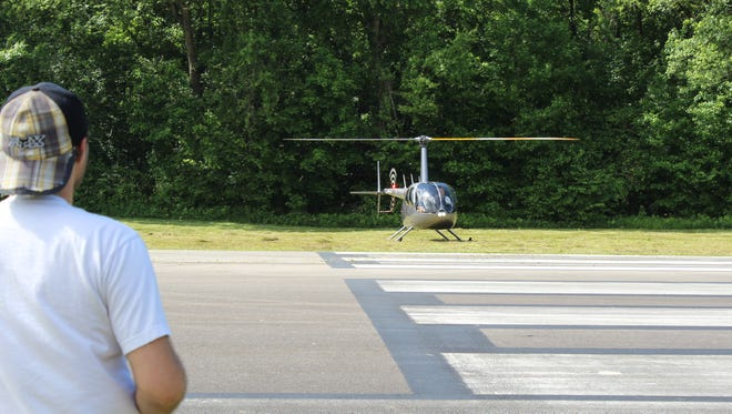 Hampton Pitts and Michel Garner arrived from Nashville via helicopter for the Fly-In Cruise-In event.
