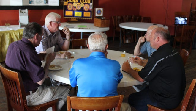 Those celebrating the 40th anniversary of the Houston County Lions Club feast together.