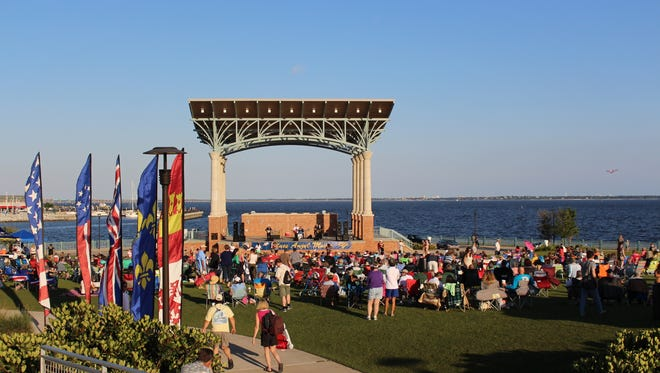 Residents gather for the Pensacola Parks and Recreation Department Summer Concert Series with Blues Angel Music.