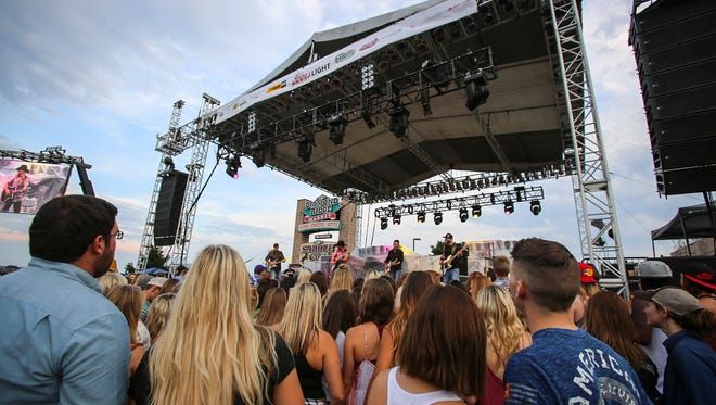 Fans watched Jason Pritchett and the Steel Horses, the supporting act for singer Michael Ray and country band Old Dominion, at PFI's Party in the Parking Lot on Sept. 15, 2016.