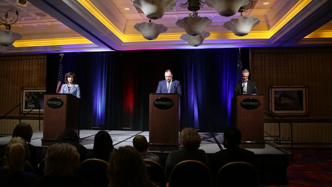 Republican candidate Heidi Gansert, left, and Democratic candidate Devon Reese debate Monday at the Peppermill. Both are running for Nevada Senate District 15.