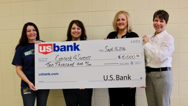 Pam Lensmire, assistant principal of North High, Amy Adamavich, a teacher at North High School, Carrie Wiginton, branch manager at US Bank, and Kristen Bergamo, assistant relationship manager at US Bank, pose with the $10,000 grant awarded to the Connect4Success program from US Bank on Sept. 16.