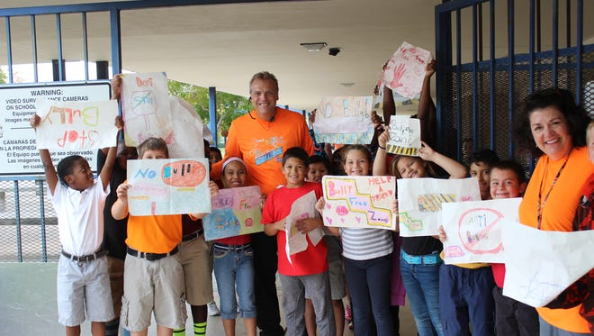 Northport principal, Glenn Rustay, walks with students on the fifth annual Unity Day Walk at the school.