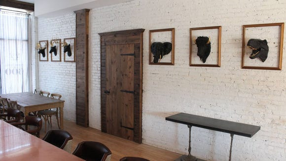 The dining room at Bodegon, 600 S. 6th St., includes some faux animal trophies.