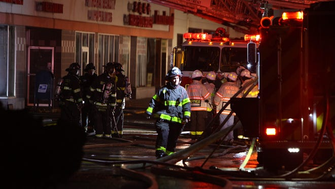 Rochester firefighters battle a  three-alarm fire at Mt. Hope Plaza on Saturday night, Nov. 19, 2016.