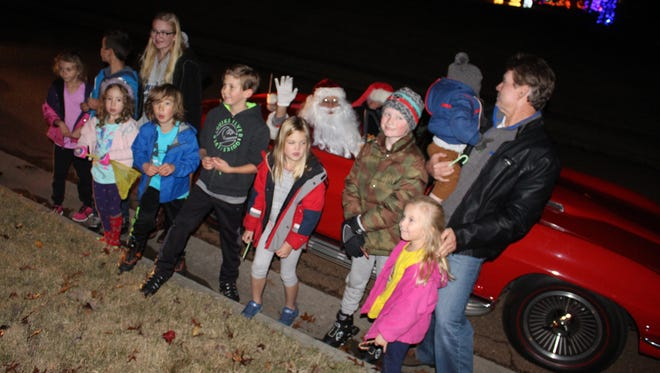 Santa brought smiles to faces of kids and adults as his cruised Oakwood Subdivision on Wednesday in a red Corvette convertible during the first of four Santa Sightings.