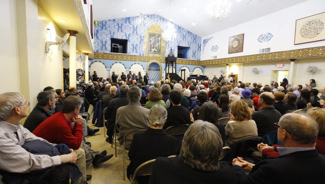 Hundreds of people fill the Islamic Society of Delaware for an interfaith service on Monday night. The service came after an executive order from President Trump that barred refugees from entry to the United States sparked protests across the country this week.