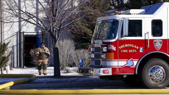 A Sheboygan firefighter leaves the Gateway drive location of Nemak Thursday February 9, 2017 in Sheboygan following report of a fire at the plant.