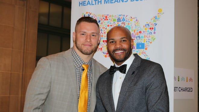 Washington Redskins linebacker Will Compton, left, with physician Jerome Adams, who is Indiana State Health Commissioner at the U.S. Chamber of Commerce Foundation's Health Means Business summit.