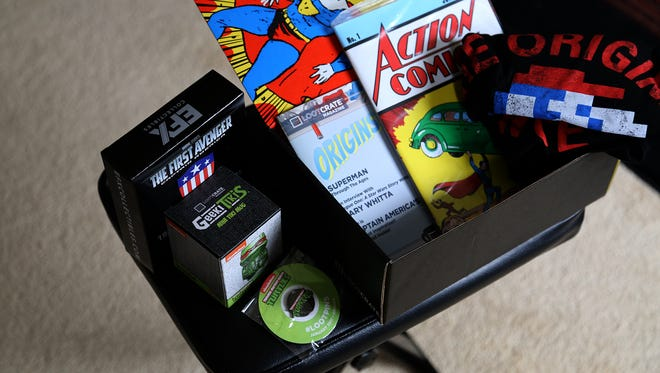 Unboxing the Loot Crate  January 2017 Origins Box, which includes items from comic book staples such as Superman, Captain America and Teenage Mutant Ninja Turtles.