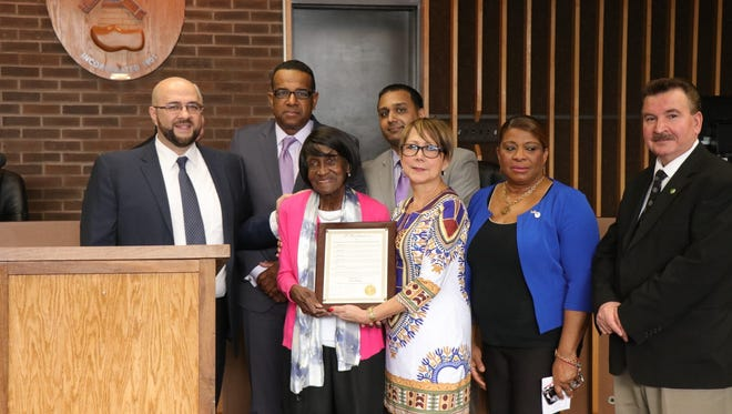 Ruth Franklin (center) is honored during Black History Month in Prospect Park. She is joined by council members Esther Perez, Felicia Ortiz, and Adnan Zakaria (front row) and Mayor Mohamed Khairullah, Council President Robert Artis, and Councilman Anand Shah (back row).
