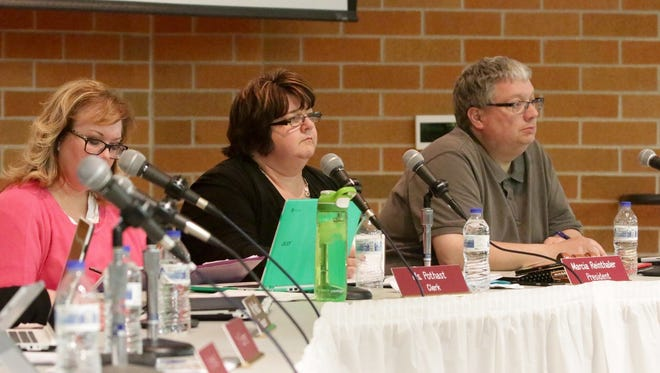 From left: Sheboygan Area School Board members Jennifer Pothast, President Marcia Reinthaler and Vice President David Gallianetti listen to speakers at a community input session on Tuesday.