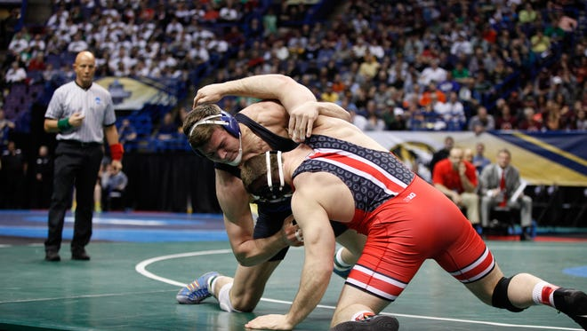 Lexington grad Jacob Kasper battles with Olympic, world and now two-time NCAA champ Kyle Snyder of Ohio State in the semifinals of the NCAA Championships.