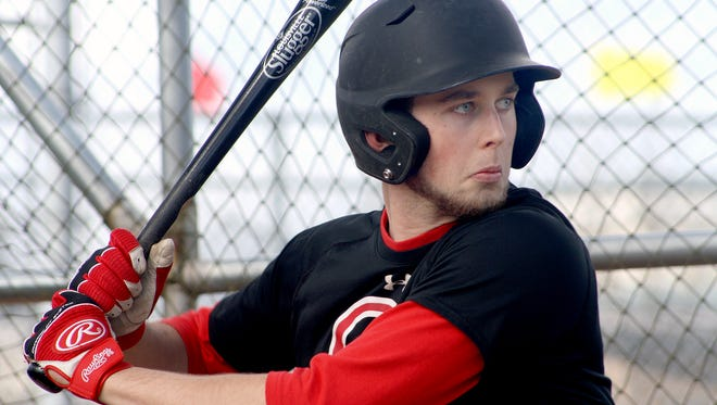 Olympic College baseball player Connor Green takes batting practice on Saturday, March 25, at Legion Field in Bremerton. Green, a North Kitsap graduate, is the team's starting catcher.