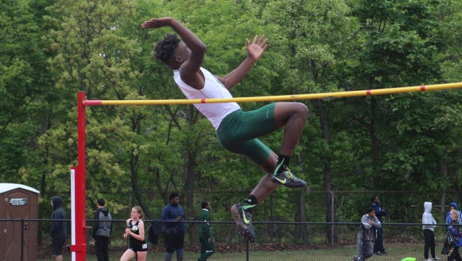 South Plainfield's Deshai Smith sets school record in high jump at 6-7 on his way to gold.