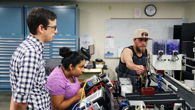 Instructor Andrew Daniels supervises students at Truckee Meadows Community College's William N. Pennington Applied Technology Center on July 25, 2017. The training is part of the Panasonic Preferred Pathway or P3 program for advanced manufacturing jobs at the Tesla Gigafactory.