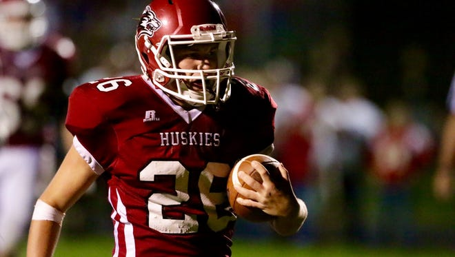 New Holstein's Bradley Schroeder (26) carries the ball in for a touchdown Friday against Valders in New Holstein.