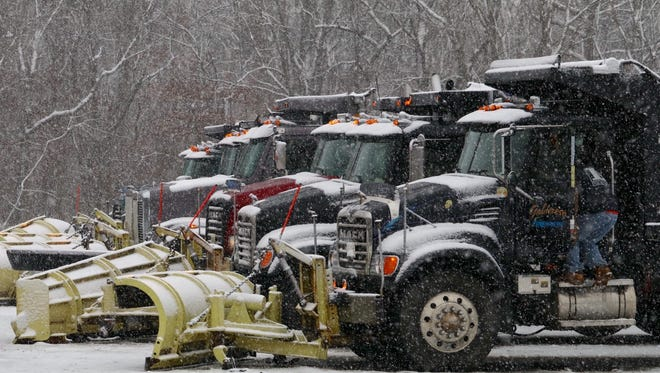 Snow plows wait to deploy in Jackson Township before a storm last year.
