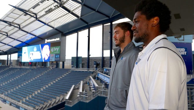University of West Florida quarterback Mike Beaudry and linebacker Reggie Barnes look out over the field at Children's Mercy Park in Kansas City, Kansas,