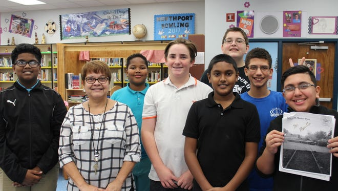 Northport instructor Elizabeth Montilla and students work diligently on Project Citizen. Their passionate work is about trying to get a sidewalk on Curtis Street adjacent to the school.