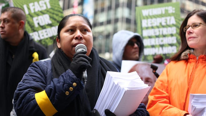 Protesters in New York City during the week of March 12, 2018, brave the cold to pressure Wendy's to join the Fair Food Program by the Coalition of Immokalee Workers.