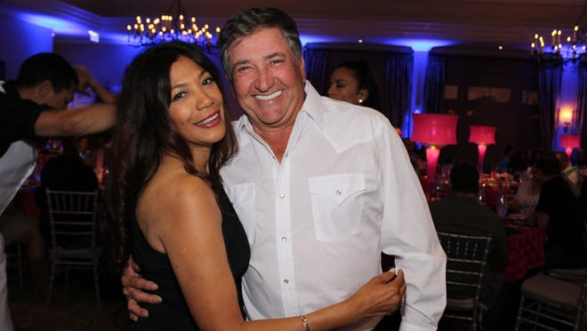 Dr. Sonia Rocha and Larry Farrell enjoy dancing at the Boogie Bash gala in Naples in March 2018.