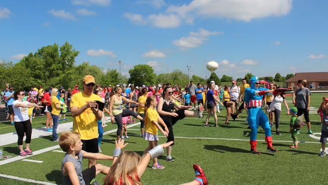 Participants take part in the first Superhero Stomp in May 2017. This year's event will be May 20.