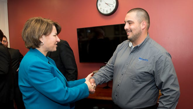 Sen. Amy Klobuchar, D-Minn., meets with David Ohnstad, lead route driver at Bernick's, in Washington, D.C.