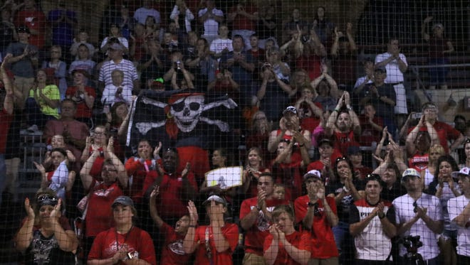Cardington's fans give a standing ovation following last year's 9-4 Division III state championship loss to Warren Champion in Akron's Firestone Stadium. Some places around the state still see the importance of high school athletics, but it's still waning.